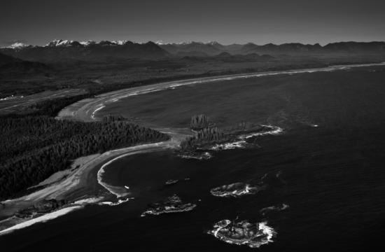 The beaches of Clayoquot Sound, including Long Beach, seen here with the Estevan Coastal Plain lying behind, consist of debris from the last ice age 10,000 to 12,000 years ago. Waves ground the material into long, sandy beaches.