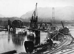 The original Second Narrows Bridge nears completion in the spring of 1925. NVMA 9736