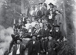 The North Vancouver mountains have always been a destination for urbanites in search of wilderness recreation. This group of hikers poses near the top of Grouse Mountain in 1906. NVMA 55