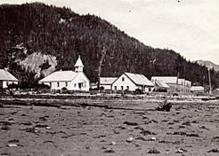 The community of Kingcolith on the Nass River, 1881. The row housing to the right of the photo is the same type of housing that can be seen at Metlakatla. American Museum of Natural History